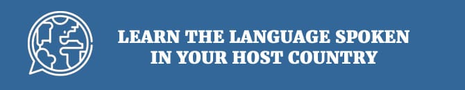 learn the language spoken in your host country